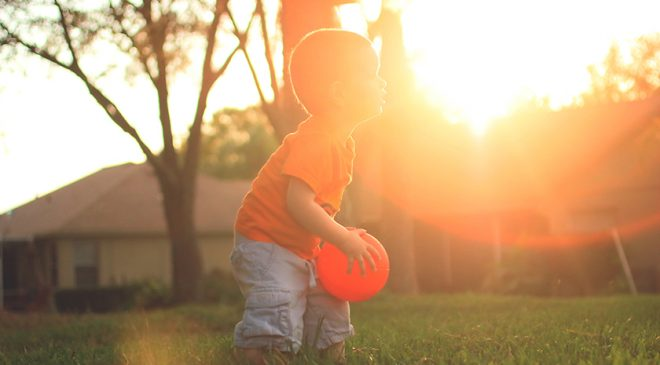 kid playing with a ball